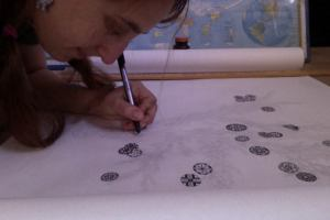 Inking the illustration for chapter C: the magical rowan tree. Mandalas feature prominently in the scroll.