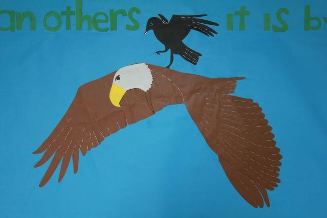 A crow riding an eagle